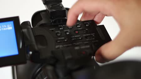 cimborák : Cameraman uses the VCD commands panel, and plays and rewinds footage on a professional video camera.