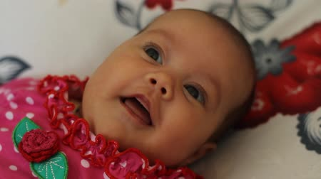vigyorgó : Close up with a 2 month  little baby girl smilling and havin fun.