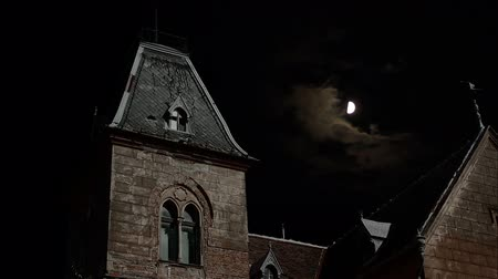 konak : Abandoned old possible ghosts haunted place, shot nighttime with moon and clouds in background. Suitable for horrorghostscrimescary stories.