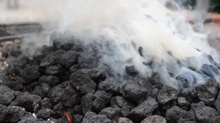 faszén : Burning coal smokes white and dense smoke. Coal is a combustible black or brownish-black sedimentary rock usually occurring in rock strata in layers or veins called coal beds or coal seams. The harder forms, such as anthracite coal, can be regarded as met