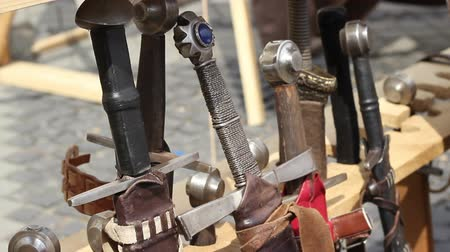 rycerz : Various medieval swords with different handles and sheaths.