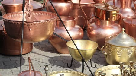 hammered : Shiny handmade brass and copper pots.