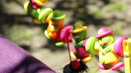 toy : Colorful hanging pinata clowns toys waving on a wire. Stock Footage