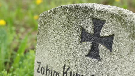 wwi : Iron cross mark painted on old tombstone from WWI.