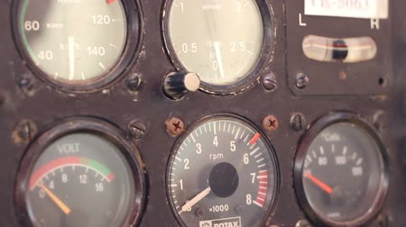 navigáció : Old flight instrument for air navigation and engine states on a rusty knobs and dials airplane cockpit panel. Stock mozgókép