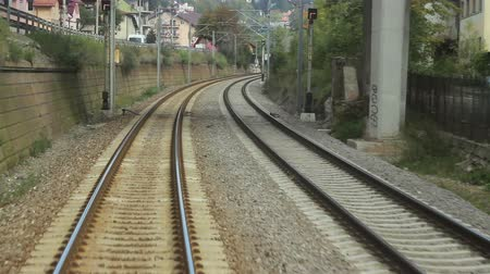 dik : Moving view of railways tracks while advancing with speed. Track consists of two parallel steel rails, anchored perpendicular to members called ties sleepers of timber, concrete, steel, or plastic to maintain a consistent distance apart, or rail gauge. Stok Video