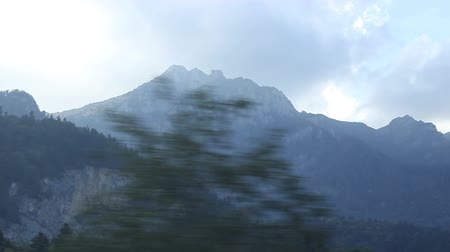 mozdony : Steep mountian view near the railroad, view from travelling train.