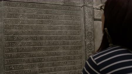 sumerian : Girl is looking to very old Sumerian inscription.