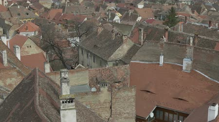 zastřešení : Pan shot over old tiles roofs in an old neighbourhood.