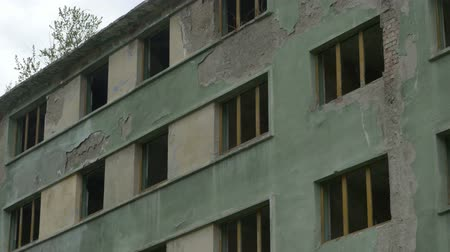 destruct : Pan shot to an abandoned apartment building without windows. Stock Footage
