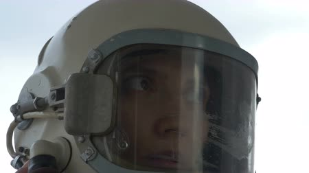 komutan : Close up shot of female cosmonaut talking with the ground base.