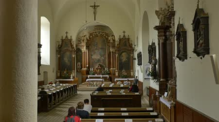 clerical : People in benches in a cathlolic church waiting for the sermon. Stock Footage