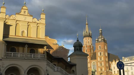 sukiennice : Oldtown Krakow, Poland, medieval buildings and church. Stock Footage