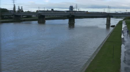 wisla : The river Vistula and bridge in Krakow, Poland, on a grey cold day. Stock Footage