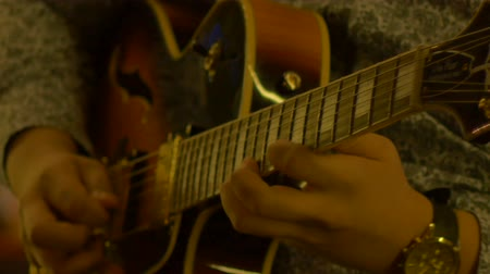 fingertips : Close-up shot of guitarist fingers performing a rock guitar song solo, at nighttime. Stock Footage