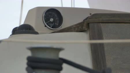 rpm : Nautical dial gauge on a travelling yacht. Stock Footage