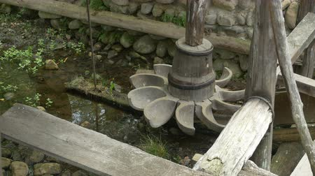 potraviny : Wood water mill large propeller with water cups and shaft.