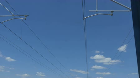 pólos : Electrical wires and poles seen from moving train.