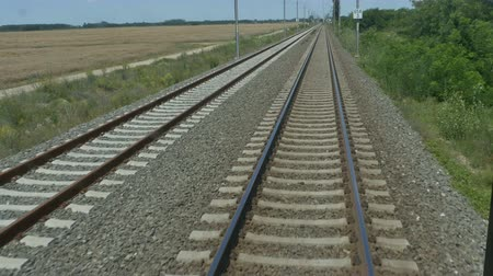 siding : Running railroad with metal rails and gravel view. Stock Footage