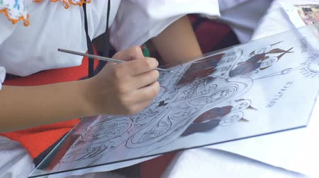 biblia : Young girl artisan is painting a religious orthodox icon on glass.