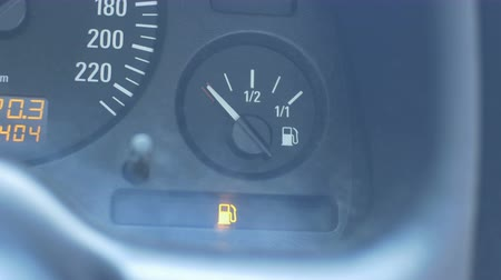 kilometer : Low level fuel LED signaling on car board. Stock Footage