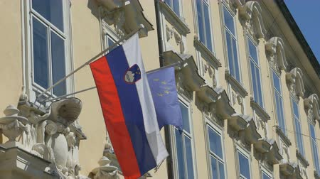 ljubljana : View of Slovenia and European Union flags on building. Stock Footage