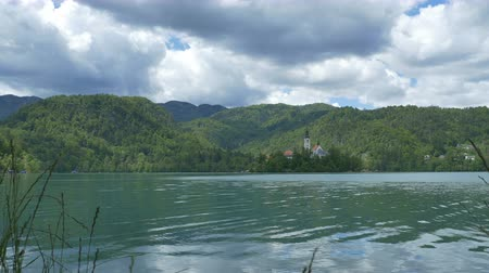 temple bell : View of the beautiful island in the Bled lake, Slovenia. Stock Footage
