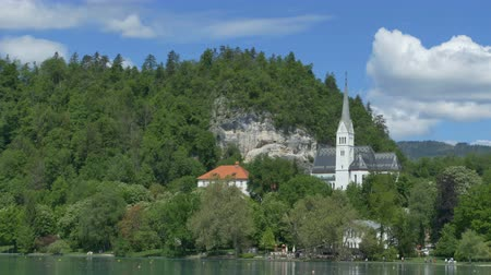 pounds : View of church on the shore of Lake Bled, in summer day.