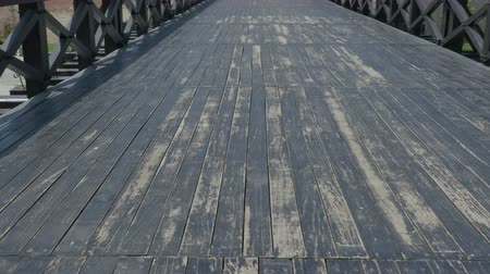 vanish : Walking over old medieval black wood bridge.