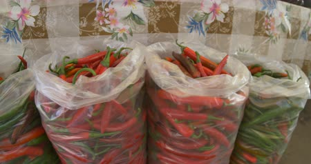 Plastic bags with chili at local market. Stok Video