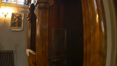 View of a baroque catholic confessional box.