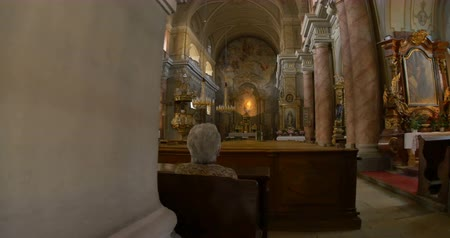 baptist : Older woman praying in a Catholic old church.