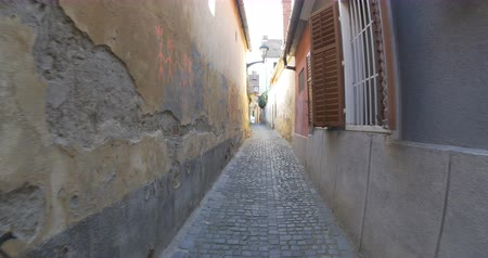 saxon : Walking throuh narrow cobblestone alley in a medieval town.