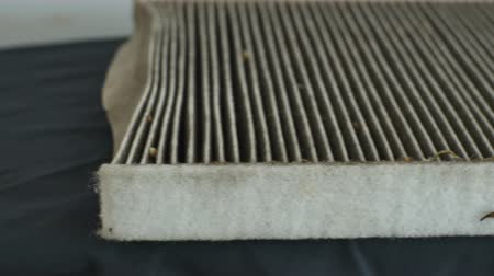 poros : View of a dusty old cabin air filter of a car.