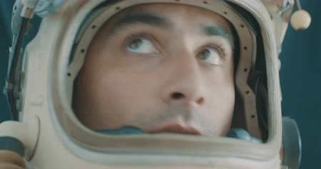 Portrait of an attentive cosmonaut. Stok Video