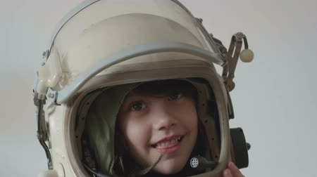 Little pretty girl smiling with astronaut helmet .