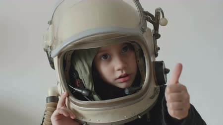 scholar : Little cosmonaut girl shows ok sign.