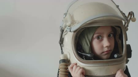 Little pretty girl astronaut smilling. Stok Video