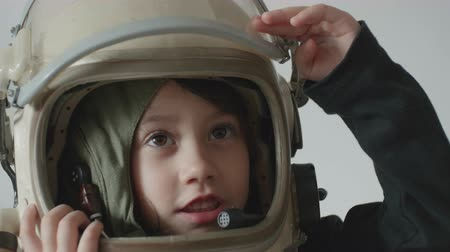 scholar : Cosmonaut little girl salutes before mission launching.