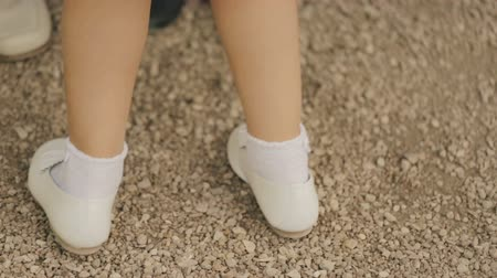 sapato : Little girl dancing in white shoes.