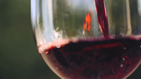 wine red : Red wine poured into glass.