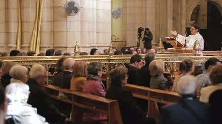 liturgy : MURCIA,SPAIN-MARCH 20,2016:Priest conducting the  Mass Dominica in Palmis  on March 20,2016 in Murcia,Spain.