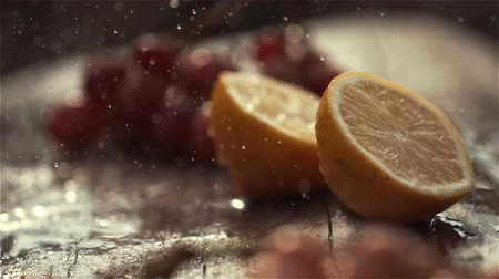 Pouring water on tasty green apple, slow motion shot at 480fps Dostupné videozáznamy
