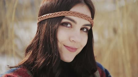hippi : Close up portrait of a beautiful brunette a boho style hippie girl.