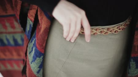kamış : Close-up hands of a hippie girl on the belt. Stok Video