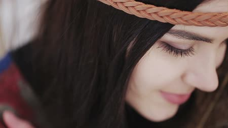 Close up portrait of a beautiful brunette a boho style hippie girl.