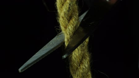 tightrope : Cutting the rope with scissors. Stock Footage