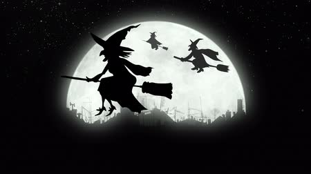 harridan : Witches flying over the city at night. Stock Footage
