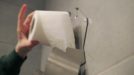 wipe away : Taking out whole roll of toilet paper.