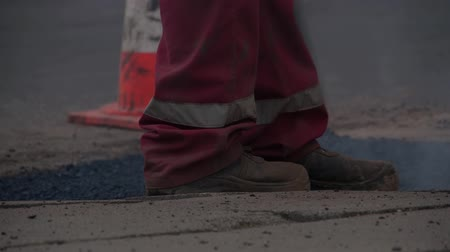 levelling : Levelling asphalt on the street. Stock Footage